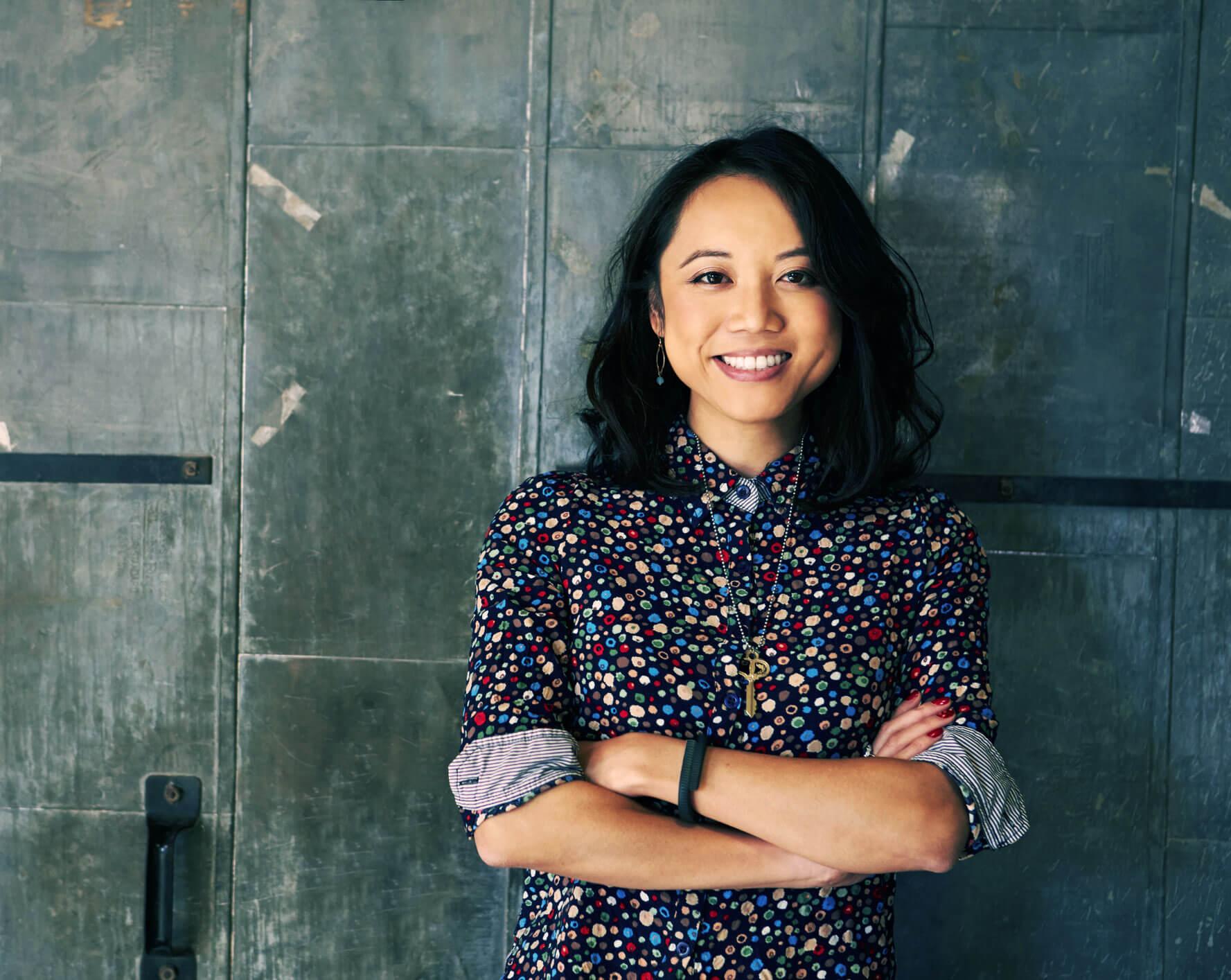 Portrait-Of-Female-Designer-Standing-In-Modern-Office-502176756_2125x1416
